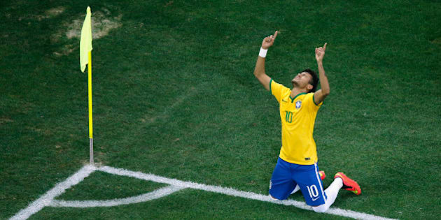 SAO PAULO, BRAZIL - JUNE 12:  Neymar of Brazil celebrates scoring his second goal on a penalty kick in the second half during the 2014 FIFA World Cup Brazil Group A match between Brazil and Croatia at Arena de Sao Paulo on June 12, 2014 in Sao Paulo, Brazil.  (Photo by Fabrizio Bensch - Pool/Getty Images)