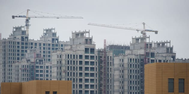 A photo taken on August 18, 2012 shows ongoing construction in the inner Mongolian city of Ordos. Miss China won the coveted title of Miss World on August 18, triumphing on home soil during a glitzy final held in a mining city on the edge of the Gobi desert. The city has grown rich over the past decade on the back of a coal mining boom that has transformed it from a sandstorm-afflicted backwater into one of the wealthiest places in China. The boom triggered a frenzy of building in the city, but the local government has struggled to fill the vast tower blocks that sprung up, earning it the title of China's biggest ghost town. AFP PHOTO / Ed Jones        (Photo credit should read Ed Jones/AFP/GettyImages)