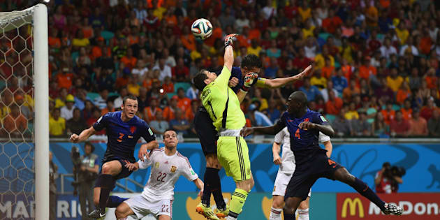 SALVADOR, BRAZIL - JUNE 13:  Iker Casillas of Spain and Robin van Persie of the Netherlands collide in the air as the ball carries to Stefan de Vrij of the Netherlands during the 2014 FIFA World Cup Brazil Group B match between Spain and Netherlands at Arena Fonte Nova on June 13, 2014 in Salvador, Brazil. De Vrij scored his teams third goal as a result.  (Photo by David Ramos/Getty Images)