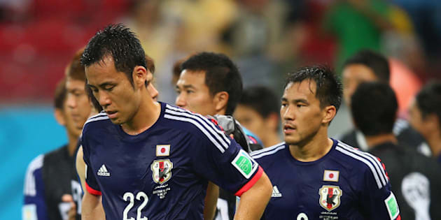 RECIFE, BRAZIL - JUNE 14: Maya Yoshida (L) and Shinji Okazaki of Japan walk off the field after being defeated by the Ivory Coast 2-1 during the 2014 FIFA World Cup Brazil Group C match  between the Ivory Coast and Japan at Arena Pernambuco on June 14, 2014 in Recife, Brazil.  (Photo by Clive Rose/Getty Images)