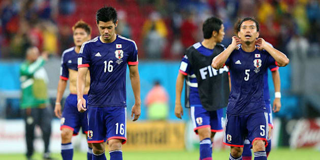 RECIFE, BRAZIL - JUNE 14: Hotaru Yamaguchi (L) and Yuto Nagatomo of Japan walk off the field after losing to the Ivory Coast 2-1 during the 2014 FIFA World Cup Brazil Group C match  between the Ivory Coast and Japan at Arena Pernambuco on June 14, 2014 in Recife, Brazil.  (Photo by Jamie Squire/Getty Images)