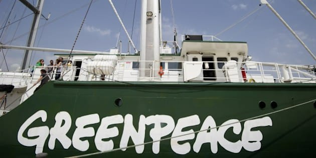 Crew members work on board environmental NGO Greenpeace's ship Rainbow Warrior docked in Valencia port on June 8, 2014. Greenpeace activist arrived in Valencia today as part of an eight day action protesting oil prospection off the coast of Spain, specifically the Balearic and Canary Islands.  AFP PHOTO/ JOSE JORDAN        (Photo credit should read JOSE JORDAN/AFP/Getty Images)
