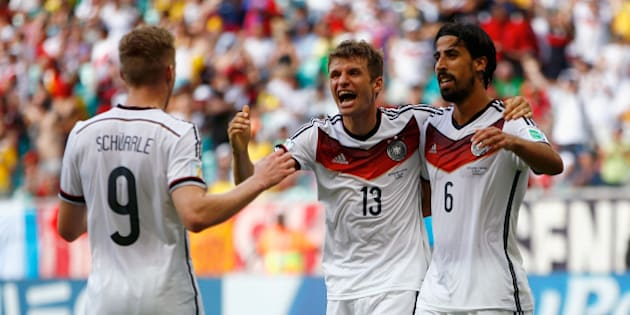 SALVADOR, BRAZIL - JUNE 16:  Thomas Mueller of Germany (C) celebrates scoring his team's fourth goal and completing his hat trick with Andre Schuerrle (L) and Sami Khedira (R) during the 2014 FIFA World Cup Brazil Group G match between Germany and Portugal at Arena Fonte Nova on June 16, 2014 in Salvador, Brazil.  (Photo by Phil Walter/Getty Images)