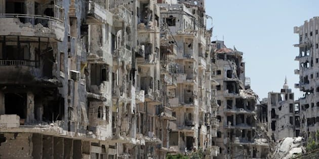 Destroyed buildings are seen in the Homs neighbourhood of Khaldiyeh, formerly held by rebel fighters and captured by Syrian government forces in summer 2013, on June 3, 2014. Syrian rebels evacuated Homs in May in a deal that handed the Old City back to the government, granting it a symbolic victory. The pullout leaves the rebels confined to a single district on the outskirts of Homs, Syria's third city and once dubbed 'the capital of the revolution' against President Bashar al-Assad.  AFP PHOTO/JOSEPH EID        (Photo credit should read JOSEPH EID/AFP/Getty Images)