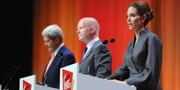 LONDON, ENGLAND - JUNE 13:  (L-R) United States Secretary of State John Kerry, British Foreign Secretary William Hague and UN Special Envoy and actress Angelina Jolie attend the Global Summit to End Sexual Violence in Conflict at ExCel on June 13, 2014 in London, England. The four-day conference on sexual violence in war is hosted by Foreign Secretary William Hague and UN Special Envoy and actress Angelina Jolie.  (Photo by Eamonn M. McCormack/Getty Images)