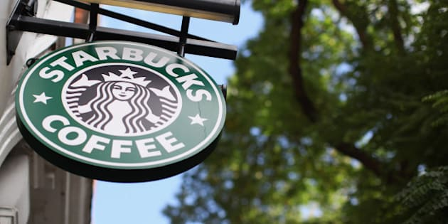 LONDON, ENGLAND - OCTOBER 16:  The signage on a branch of Starbucks Coffee on October 16, 2012 in London, England. It has been reveled that Starbucks, the world's second largest coffee chain, has paid no tax in the UK for the past three years despite sales exceeding 1 billion GBP. Since first trading in the UK in 1998 Starbucks has paid 8.6 million GBP in income tax with total sales of over 3 billion GBP in the same period.  (Photo by Oli Scarff/Getty Images)