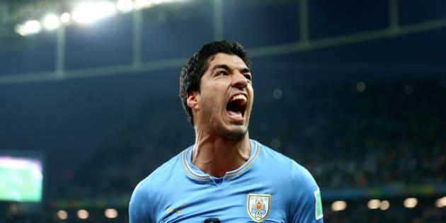 Uruguay's Luis Suarez celebrates scoring his side's second goal during the Group D match the Estadio do Sao Paulo, Sao Paulo, Brazil.