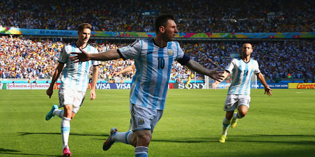 BELO HORIZONTE, BRAZIL - JUNE 21:  Lionel Messi of Argentina celebrates scoring his team's first goal during the 2014 FIFA World Cup Brazil Group F match between Argentina and Iran at Estadio Mineirao on June 21, 2014 in Belo Horizonte, Brazil.  (Photo by Ronald Martinez/Getty Images)