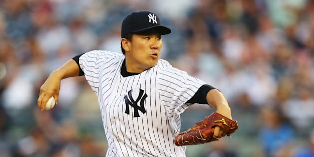 NEW YORK, NY - JUNE 17:  Masahiro Tanaka #19 of the New York Yankees pitches against the Toronto Blue Jays in the first inning during their game at Yankee Stadium on June 17, 2014 in the Bronx borough of New York City.  (Photo by Al Bello/Getty Images)