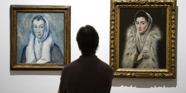 A man looks at the painting 'Lady in a Fur Wrap' (1577-78) (R) by Spanish's painter El Greco and 'Lady in a Fur Wrap, after El Greco' (L) (1885-86) by French's painter Paul Cézanne during the presentation to the press of the exhibition dubbed the 'El Greco and Modern Painting' at the Prado National museum in Madrid on June 23, 2014. The exhibit runs from June 24th to October 5th 2014 . RESTRICTED TO EDITORIAL USE, MANDATORY MENTION OF THE ARTIST UPON PUBLICATION, TO ILLUSTRATE THE EVENT AS SPECIFIED IN THE CAPTION AFP PHOTO / GERARD JULIEN      RESTRICTED TO EDITORIAL USE, MANDATORY MENTION OF THE ARTIST UPON PUBLICATION, TO ILLUSTRATE THE EVENT AS SPECIFIED IN THE CAPTION        (Photo credit should read GERARD JULIEN/AFP/Getty Images)