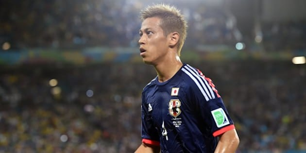 Japan's forward Keisuke Honda is pictured during a Group C match between Japan and Greece at the Dunas Arena in Natal during the 2014 FIFA World Cup on June 19, 2014.   AFP PHOTO / ARIS MESSINIS        (Photo credit should read ARIS MESSINIS/AFP/Getty Images)