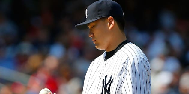NEW YORK, NY - JUNE 22: Masahiro Tanaka #19 of the New York Yankees looks at the ball after surrendering a run in the seventh inning against the Baltimore Orioles at Yankee Stadium on June 22, 2014 in the Bronx borough of New York City. (Photo by Jim McIsaac/Getty Images)