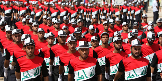 Members of the Iraqi Sadr Movement's Mahdi Army march in Baghdad's predominantly Shiite suburb of Sadr City on May 26, 2011 during a parade demanding the withdrawal of US forces from Iraq. AFP PHOTO/AHMAD AL-RUBAYE (Photo credit should read AHMAD AL-RUBAYE/AFP/Getty Images)