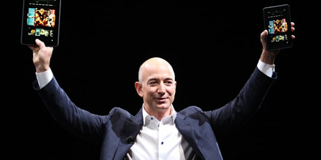 SANTA MONICA, CA - SEPTEMBER 6:  Amazon CEO Jeff Bezos holds up the new Kindle Fire HD reading device in two sizes during a press conference on September 6, 2012 in Santa Monica, California. Amazon unveiled the Kindle Fire HD in 7 and 8.9-inch sizes, with prices starting at $199. (Photo by David McNew/Getty Images)