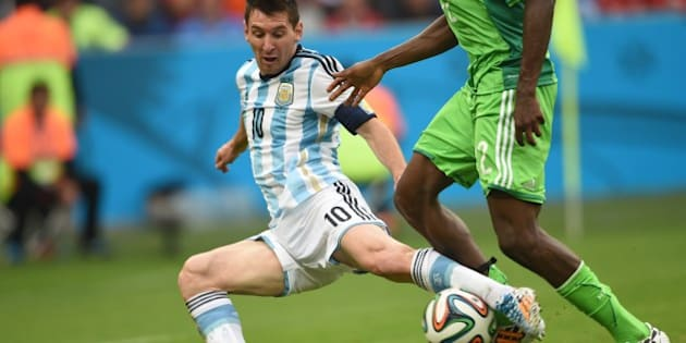 Argentina's forward Lionel Messi  (L) vies for the ball with Nigeria's defender Kenneth Omeruo, during a Group F football match between Nigeria and Argentina at the Beira-Rio Stadium in Porto Alegre during the 2014 FIFA World Cup on June 25, 2014.   AFP PHOTO / PEDRO UGARTE        (Photo credit should read PEDRO UGARTE/AFP/Getty Images)