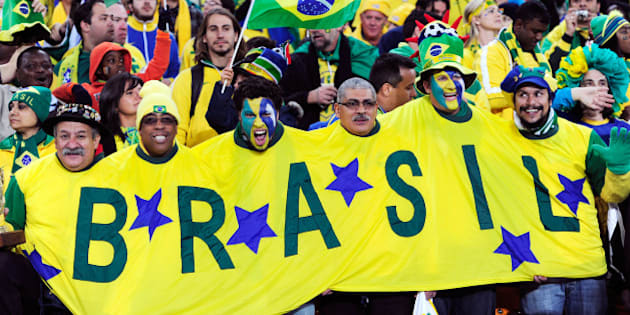 JOHANNESBURG, SOUTH AFRICA - JUNE 20:  Brazil fans enjoy the atmosphere prior to the 2010 FIFA World Cup South Africa Group G match between Brazil and Ivory Coast at Soccer City Stadium on June 20, 2010 in Johannesburg, South Africa.  (Photo by Stuart Franklin/Getty Images)