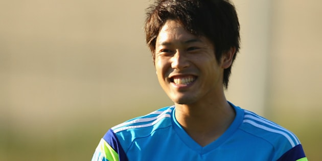 ITU, BRAZIL - JUNE 12:  Atsuto Uchida laughs as he watches on during a Japan training session at the Japan national team base camp at the Spa Sport Resort on June 12, 2014 in Itu, Sao Paulo.  (Photo by Mark Kolbe/Getty Images)