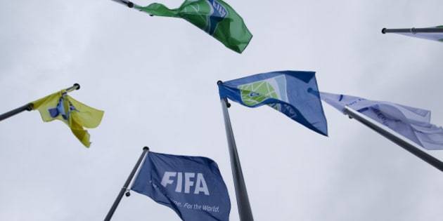 Flags of the World Soccer Association FIFA are seen in front of it's headquarter in Zurich, on October 20, 2010. FIFA has summoned senior Nigerian and Oceanian officials Amos Adamu and Reynald Temarii to a committee meeting on Wednesday which is investigating allegations of votes being sold in World Cup bidding. AFP PHOTO / SEBASTIAN DERUNGS (Photo credit should read SEBASTIAN DERUNGS/AFP/Getty Images)