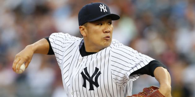 NEW YORK, NY - JUNE 28: Masahiro Tanaka #19 of the New York Yankees delivers a pitch against the Boston Red Sox during the first inning in a MLB baseball game at Yankee Stadium on June 28, 2014 in the Bronx borough of New York City. (Photo by Rich Schultz/Getty Images)