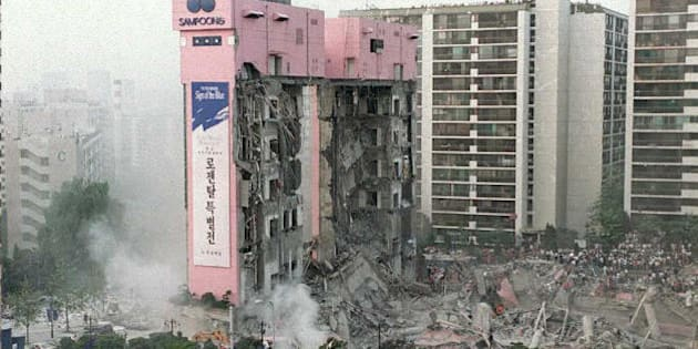 SEOUL, REPUBLIC OF KOREA:  An overview of the collapsed Sampoong Department store 29 June where scores of rush hour shoppers and staff were trapped under debris. Initial reports attribute the collapse to a gas explosion. At least 20 bodies have been recovered and 615 people hospitalized. AFP PHOTO  (Photo credit should read CHOO YOUN-KONG/AFP/Getty Images)