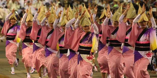TOKUSHIMA, JAPAN - AUGUST 12:  Japanese women dressed in traditional costume perform Awa-Odori dance during the annual 'Awa odori' or Awa Dance Festival on August 12, 2013 in Tokushima, Japan. The traditional Japanese dancing performance festival is held from 12 to 15 August as part of the Obon festival, attracting over 1.3 million tourists.  (Photo by Buddhika Weerasinghe/Getty Images)