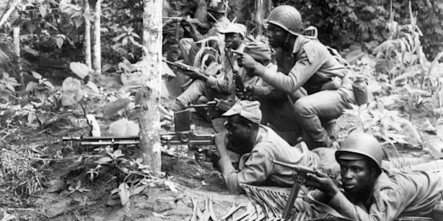 LAGOS, NIGERIA - AUGUEST 16: Biafran National army soldiers prepare to resist a Federal troop attack in the Biafra region in south-eastern Nigeria, where a civil war opposing Biafra tribes fighting for independance and the federal troops killed between one and two milllion people from 1967 and 1970.