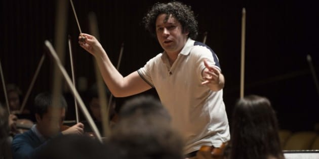 Venezuelan maestro Gustavo Dudamel, conductor of Venezuela's world-famous Simon Bolivar National Youth Orchestra, conducts the San Francisco Berkeley University Orchestra during a masterclass in San Francisco, California, on November 27, 2012 before the kick off of a US tour on November 29. The Simon Bolivar National Orchestra is part of 'The System' or Social Action for Music, conceived by Venezuelan conductor and composer Jose Antonio Abreu is a state foundation that supports youth orchestras to encourage children from poor backgrounds to adapt to school and society while learning musical instruments with orchestra members.  AFP PHOTO/LEO RAMIREZ        (Photo credit should read LEO RAMIREZ/AFP/Getty Images)