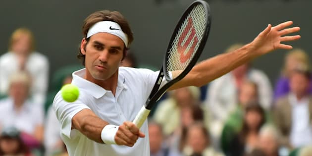 LONDON, ENGLAND - JUNE 26:  Roger Federer of Switzerland returns the ball to Gilles Muller of Luxembourg during their men's singles second round match on day four of the 2014 Wimbledon Championships at the All England Tennis and Croquet Club at Wimbledon in London, England on June 26, 2014. (Photo by Yunus Kaymaz/Anadolu Agency/Getty Images)