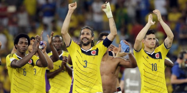 Colombia's James Rodriguez, right, Mario Yepes, center, and  Carlos Sanchez Moreno, left, celebrate after the World Cup round of 16 soccer match between Colombia and Uruguay at the Maracana Stadium in Rio de Janeiro, Brazil, Saturday, June 28, 2014. James Rodriguez scored twice to put Colombia into the World Cup quarterfinals for the first time in a 2-0 victory over Uruguay on Saturday.(AP Photo/Antonio Calanni)