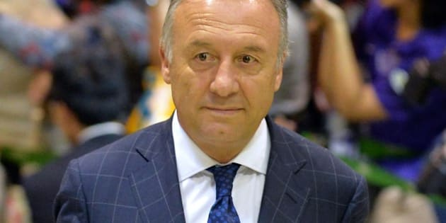 Japan national football team coach Alberto Zaccheroni arrives at Narita Airport on June 27, 2014. Japan's World Cup squad returned home after a winless campaign in Brazil.  AFP PHOTO / KAZUHIRO NOGI        (Photo credit should read KAZUHIRO NOGI/AFP/Getty Images)