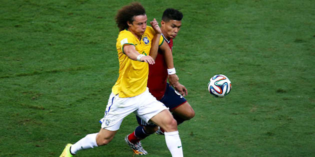FORTALEZA, BRAZIL - JULY 04:  David Luiz of Brazil and Teofilo Gutierrez of Colombia compete for the ball during the 2014 FIFA World Cup Brazil Quarter Final match between Brazil and Colombia at Castelao on July 4, 2014 in Fortaleza, Brazil.  (Photo by Michael Steele/Getty Images)