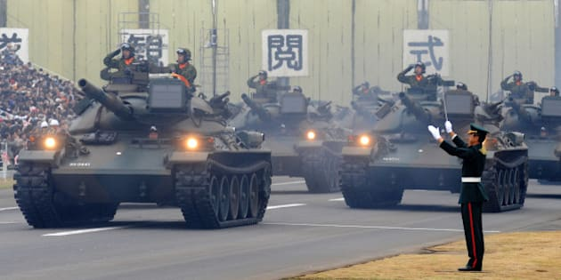 A tank unit takes part in an inspection parade at the Asaka base in suburban Tokyo on October 24, 2010. Around 3,800 personnel, 240 armored vehicles and 60 aircraft participated in the inspection parade.    AFP PHOTO/Kazuhiro NOGI (Photo credit should read KAZUHIRO NOGI/AFP/Getty Images)