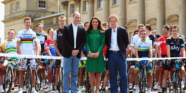 LEEDS, ENGLAND - JULY 05:  (l to r) Prince William, Duke of Cambridge, Catherine, Duchess of Cambridge and Prince Harry pose at the official start of stage one of the 2014 Tour de France, a 190km stage between Leeds and Harrogate, on July 5, 2014 in Leeds, England.  (Photo by Bryn Lennon/Getty Images)