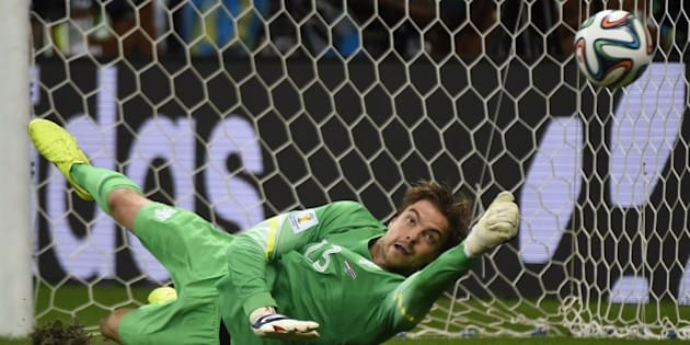 Netherlands' goalkeeper Tim Krul saves a penalty during the penalty shoot-out of the quarter-final football match between the Netherlands and Costa Rica at the Fonte Nova Arena in Salvador during the 2014 FIFA World Cup on July 5, 2014.  AFP PHOTO / ODD ANDERSEN        (Photo credit should read ODD ANDERSEN/AFP/Getty Images)