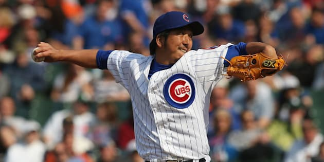 CHICAGO, IL - MAY 17:  Kyuji Fujikawa #11 of the Chicago Cubs pitches against the New York Mets at Wrigley Field on May 17, 2013 in Chicago, Illinois. The Mets defeated the Cubs 3-2.  (Photo by Jonathan Daniel/Getty Images)