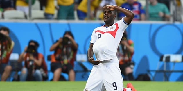 FORTALEZA, BRAZIL - JUNE 14: Joel Campbell of Costa Rica celebrates scoring his team's first goal with the ball under his jersey during the 2014 FIFA World Cup Brazil Group D match between Uruguay and Costa Rica at Castelao on June 14, 2014 in Fortaleza, Brazil.  (Photo by Laurence Griffiths/Getty Images)