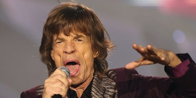 Mick Jagger of the Rolling Stones performs during a concert that is part of the band's '14 on Fire' world tour in Duesseldorf, western Germany on June 19, 2014. AFP PHOTO / DPA / OLIVER BERG +++ GERMANY OUT        (Photo credit should read OLIVER BERG/AFP/Getty Images)