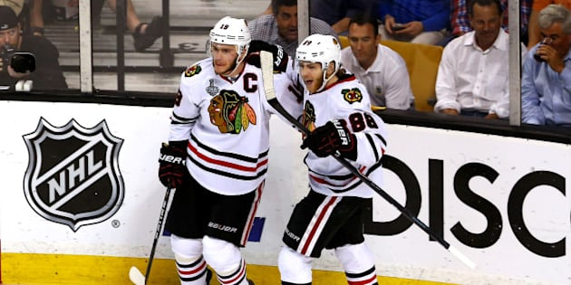 BOSTON, MA - JUNE 24:  Jonathan Toews #19 of the Chicago Blackhawks celebrates with teammate Patrick Kane #88 after Toews scored a goal in the second period against Tuukka Rask #40 of the Boston Bruins in Game Six of the 2013 NHL Stanley Cup Final at TD Garden on June 24, 2013 in Boston, Massachusetts.  (Photo by Elsa/Getty Images)