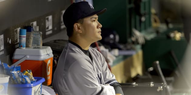 CLEVELAND, OH - JULY 8: Starting pitcher Masahiro Tanaka #19 of the New York Yankees sits in the dugout after leaving the game during the seventh inning against the Cleveland Indians at Progressive Field on July 8, 2014 in Cleveland, Ohio.  (Photo by Jason Miller/Getty Images)