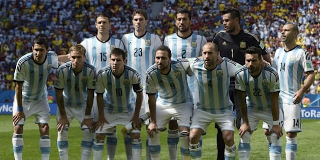 Argentina's national team (from top L) defender Martin Demichelis, defender Jose Maria Basanta, defender Ezequiel Garay, goalkeeper Sergio Romero, midfielder Javier Mascherano, (from bottom L) midfielder Angel Di Maria, midfielder Lucas Biglia, forward and captain Lionel Messi, forward Gonzalo Higuain, defender Pablo Zabaleta and forward Ezequiel Lavezzi pose before a quarter-final football match between Argentina and Belgium at the Mane Garrincha National Stadium in Brasilia during the 2014 FIFA World Cup on July 5, 2014. AFP PHOTO / JUAN MABROMATA        (Photo credit should read JUAN MABROMATA/AFP/Getty Images)