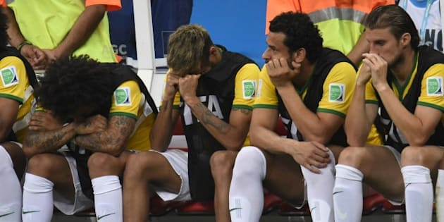 (L-R) Brazil's defender Marcelo, Brazil's injured forward Neymar, Brazil's forward Fred and Brazil's defender Henrique react on the bench at the end of the third place play-off football match between Brazil and Netherlands during the 2014 FIFA World Cup at the National Stadium in Brasilia on July 12, 2014. Netherlands won 3-0.  AFP PHOTO / FABRICE COFFRINI        (Photo credit should read FABRICE COFFRINI/AFP/Getty Images)