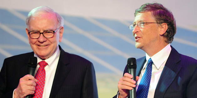 TO GO WITH Lifestyle-India-poverty-charity-US-Gates-Buffett,ADVANCER by Penny MacRae(FILES) In this photograph taken on September 29, 2010, leading US businessmen Warren Buffett (L) and Bill Gates (R) speak at the nationwide launch ceremony of Chinese electric vehicle BYD M6 in Beijing. Two of the world's richest men, software czar Bill Gates and investor Warren Buffett, are set to visit India this week to persuade the country's super-wealthy to part with more of their money.  AFP PHOTO/Frederic J. BROWN/FILES (Photo credit should read FREDERIC J. BROWN/AFP/Getty Images)