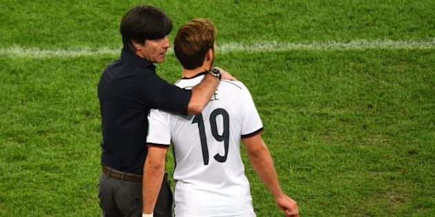 Germany's coach Joachim Loew (L) speaks with Germany's forward Mario Goetze as he comes on to play during the final football match between Germany and Argentina for the FIFA World Cup at The Maracana Stadium in Rio de Janeiro on July 13, 2014. AFP PHOTO / CHRISTOPHE SIMON        (Photo credit should read CHRISTOPHE SIMON/AFP/Getty Images)