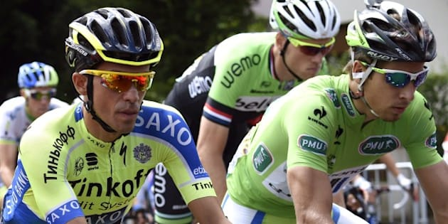 Spain's Alberto Contador (L) and Slovakia's Peter Sagan wearing the best sprinter's green jersey take the start of the 161.50 km tenth stage of the 101st edition of the Tour de France cycling race on July 14, 2014 between Mulhouse and La Planche des Belles Filles ski resort, eastern France.  AFP PHOTO / ERIC FEFERBERG        (Photo credit should read ERIC FEFERBERG/AFP/Getty Images)