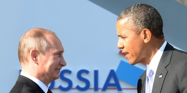 Russias President Vladimir Putin (L) welcomes US President Barack Obama at the start of the G20 summit on September 5, 2013 in Saint Petersburg. Russia hosts the G20 summit hoping to push forward an agenda to stimulate growth but with world leaders distracted by divisions on the prospect of US-led military action in Syria.      AFP PHOTO / YURI KADOBNOV        (Photo credit should read YURI KADOBNOV/AFP/Getty Images)