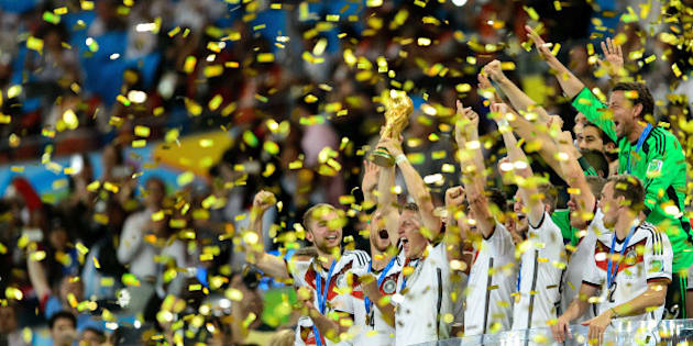 RIO DE JANEIRO, BRAZIL - JULY 13: Germany celebrate with the World Cup trophy after defeating Argentina 1-0 in extra time during the 2014 FIFA World Cup Brazil Final match between Germany and Argentina at Maracana on July 13, 2014 in Rio de Janeiro, Brazil.  (Photo by Matthias Hangst/Getty Images)