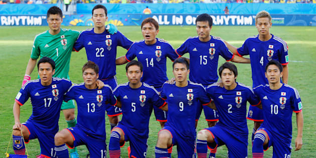CUIABA, BRAZIL - JUNE 24:  Japan players pose for a team photo during the 2014 FIFA World Cup Brazil Group C match between Japan and Colombia at Arena Pantanal on June 24, 2014 in Cuiaba, Brazil.  (Photo by Gabriel Rossi/Getty Images)