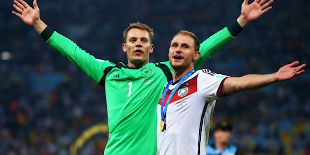 RIO DE JANEIRO, BRAZIL - JULY 13:  Manuel Neuer and Benedikt Hoewedes of Germany celebrate after defeating Argentina 1-0 in extra time during the 2014 FIFA World Cup Brazil Final match between Germany and Argentina at Maracana on July 13, 2014 in Rio de Janeiro, Brazil.  (Photo by Julian Finney/Getty Images)