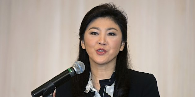 Thailand's deposed former prime minister Yingluck Shinawatra speaks during a press conference at hotel in Bangkok on July 18, 2014. Yingluck ruled out going into self-exile to avoid possible criminal charges, after the country's junta gave her permission to travel overseas.  AFP PHOTO / PORNCHAI KITTIWONGSAKUL        (Photo credit should read PORNCHAI KITTIWONGSAKUL/AFP/Getty Images)