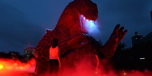 A 6.6 meter tall godzilla statue is illuminated at the Midtown park in Tokyo for the promotion of the recent godzilla movie at a press preview on July 17, 2014. The light-up godzilla from July 18 through the end of August.  AFP PHOTO / Yoshikazu TSUNO        (Photo credit should read YOSHIKAZU TSUNO/AFP/Getty Images)